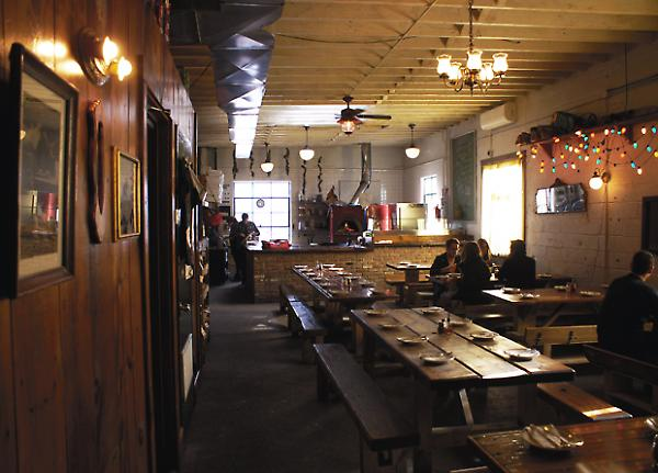 interior view, salvaged wood tables and walls